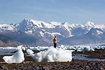 Alaska, Prince William Sound, Lone sea kayaker standing on stranded ice berg, Columbia Bay, Columbia Glacier, pack ice, USA, North America, David Fox, released,.