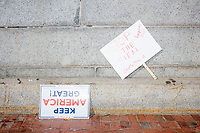 "Abandoned Trump campaign signs and others reading ""Stop The Steal"" lay outside the Massachusetts State House as people gathered there protest and celebrate the victory of US President-Elect Joe Biden over incumbent Donald Trump in Boston, Massachusetts, on Sat., Nov. 7, 2020. A small contingent of Trump supporters also gathered there and the two sides taunted one another. The Trump supporters mentioned being part of the Stop The Steal movement."