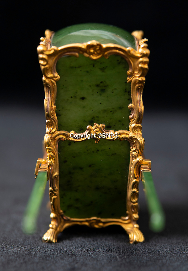 BNPS.co.uk (01202 558833)<br /> Pic: PhilYeomans/BNPS<br /> <br /> The sedan sides are crafted from solid jadeite..<br /> <br /> In from the cold - £500,000 Romanov treasure is hot property at Cotswold auction.<br /> <br /> An exquisite Faberge antique believed to have been made for the Russian Royal family over 100 years ago sold yesterday for a whopping £500,000...over 5 times it's estimate.<br /> <br /> The model of a sedan chair by the iconic Russian jewellers was one of the state treasures seized and sold off by the communist regime following the Russian Revolution.<br /> <br /> It was first sold at high-end Anglo-Russia antique dealers Wartski in London in 1929, where it was bought by a K.W Woollcombe-Boyce for only £75.<br /> <br /> The ornate item, crafted from Jadeite, gold, rock crystal and mother of pearl, has remained in the family ever since and is now being sold by a direct descendant of Mr Woollcombe-Boyce.<br /> <br /> Experts from the Cotswold Auction Company gave the small Russian antique a pre-sale estimate of only £100,000, but always anticipated it could go for much more than that.