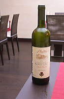 Bottle of Plantaze Cnogorski Krstac Vrhunsko Bijelo Vino white wine in the restaurant Stara Kuca Podgorica capital. Montenegro, Balkan, Europe.