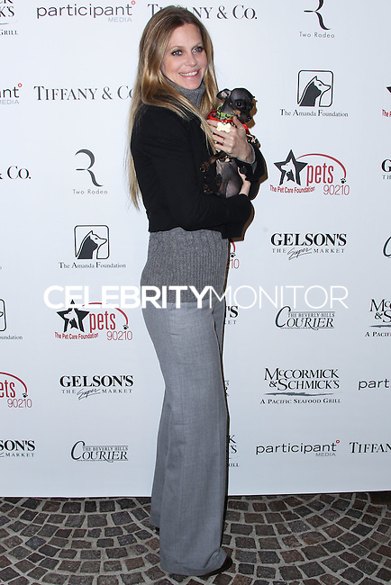 """BEVERLY HILLS, CA - OCTOBER 27: Actress Kristin Bauer van Straten arrives at the """"Bow Wow Beverly Hills"""" Presents The Big Bark Theory Halloween Event benefiting The Amanda Foundation held at Two Rodeo Drive on October 27, 2013 in Beverly Hills, California. (Photo by Xavier Collin/Celebrity Monitor)"""