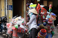 Hanoi<br /> , Vietnam - 2007 File Photo -<br /> <br /> <br /> A woman wearing a scarf to protect from pollution, near a bicycle loaded with colorfull plastic items for sale, in Hanoi.<br /> <br /> <br /> <br /> <br /> photo : James Wong-  Images Distribution