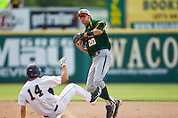 Baylor Bears shortstop Jake Miller #20 is spiked by Oral Roberts baserunner Brandon Healy during the NCAA Regional baseball game against Oral Roberts University on June 3, 2012 at Baylor Ball Park in Waco, Texas. Healy was called out for interference. Baylor defeated Oral Roberts 5-2. (Andrew Woolley/Four Seam Images)