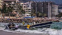 Travel Print Photograph of Mexicans trying to launch their fishing boat into the waves of Banderas Bay in Puerto Vallarta, Mexico.
