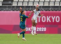 KASHIMA, JAPAN - JULY 27: Sam Kerr #2 of Australia defends Crystal Dunn #2 of the USWNT during a game between Australia and USWNT at Ibaraki Kashima Stadium on July 27, 2021 in Kashima, Japan.