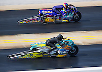 Sep 17, 2016; Concord, NC, USA; NHRA pro stock motorcycle rider Jerry Savoie (near) races alongside L.E. Tonglet during qualifying for the Carolina Nationals at zMax Dragway. Mandatory Credit: Mark J. Rebilas-USA TODAY Sports