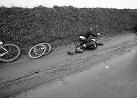 Dwars Door Vlaanderen 2013.Jack Bauer (NZL) stays down after crashing on the Ladeuze descent