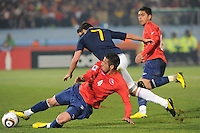 David Villa looks to spring his dribble past Chile's Mauricio Isla. Spain won Group H following a 2-1 defeat of Chile in Pretoria's Loftus Versfeld Stadium, Friday, June 25th, at the 2010 FIFA World Cup in South Africa..