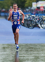 07 AUG 2011 - LONDON, GBR - Alistair Brownlee (GBR) pulls away from the field as he starts the second lap of the run during the men's round of triathlon's ITU World Championship Series .(PHOTO (C) NIGEL FARROW)