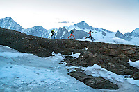 Trail running on the Pigne de la Lé, 3396 meters, at sunrise, while on the Via Valais, a multi-day trail running tour connecting Verbier with Zermatt, Switzerland.