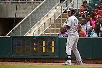 Jackson Generals third baseman Leury Bonilla (12) on deck as the pitch clock reaches eleven seconds during a game against the Montgomery Biscuits on April 29, 2015 at Riverwalk Stadium in Montgomery, Alabama.  Jackson defeated Montgomery 4-3.  (Mike Janes/Four Seam Images)
