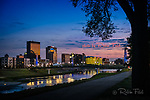 Dayton Ohio skyline, dusk with river, tree.