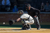 Wake Forest Demon Deacons catcher Ben Breazeale (9) reaches for a pitch as home plate umpire Drew Maher looks on during the game against the Richmond Spiders at David F. Couch Ballpark on March 6, 2016 in Winston-Salem, North Carolina.  The Demon Deacons defeated the Spiders 17-4.  (Brian Westerholt/Four Seam Images)