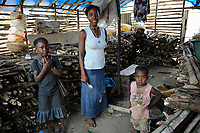 Sierra Leone, Freetown, woman sells firewood