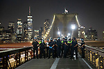 NEW YORK, NY — SEPTEMBER 25, 2020:  NYPD officers close the walkway on the Brooklyn Bridge during a protest against a Kentucky Grand Jury decision to not directly indict the officers involved in the shooting of Breonna Taylor, a 26 year-old EMT who was killed in her Louisville home by police on March 13th of this year, on September 25, 2020 in New York City.  Former police detective Brett Hankison faces three felony charges of wanton endangerment.  Photograph by Michael Nagle
