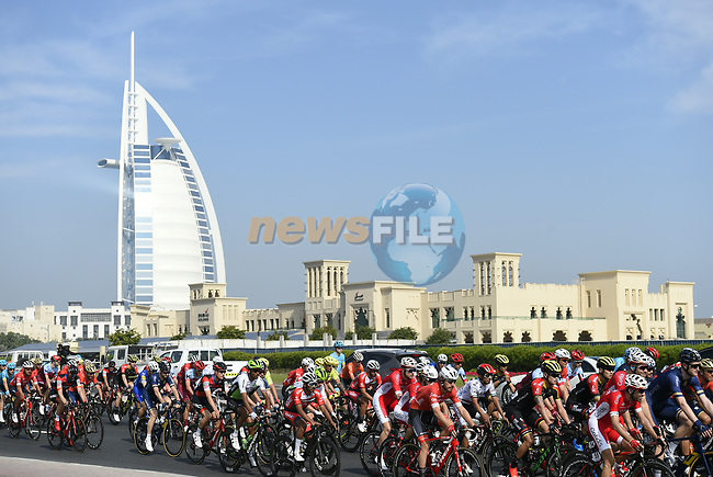 The peloton pass by the Burj al Arab during Stage 2 The Ras Al Khaimah Stage of the Dubai Tour 2018 the Dubai Tour's 5th edition, running 190km from Skydive Dubai to Ras Al Khaimah, Dubai, United Arab Emirates. 7th February 2018.<br /> Picture: LaPresse/Fabio Ferrari   Cyclefile<br /> <br /> <br /> All photos usage must carry mandatory copyright credit (© Cyclefile   LaPresse/Fabio Ferrari)
