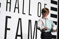 The son of hall of fame inductee Brandi Chastain holds her award at the San Jose Sports Hall of Fame induction ceremony at the HP Pavilion on Nov. 14, 2012.