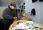 WATERBURY, CT-122717JS05----Felito Martinez, a homeless person from Waterbury, packs up some toiletry items during his visit to the Waterbury Hospitality Center on East Main Street in Waterbury. With the temperatures in the single digits, warming centers throughout the state are being opened up. People can go the center id they need a. Warm place to go from 7:30 a.m. to 3:00 p.m. But if the homeless shelter reaches its capacity, the city says it will keep the center open longer. Martinez, who says he normally sleeps on the porch of an abandoned home, will most likely go to the shelter until the temperatures warm up. <br /> Jim Shannon Republican-American