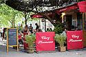 Paris, France. 09.05.2015. Tourists at a pavement cafe, Montmartre, Paris, France. Photograph © Jane Hobson.