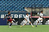 FOXBOROUGH, MA - JULY 9: Kosi Thompson #52 of Toronto FC II blocks Damian Rivera #72 of New England Revolution II cross during a game between Toronto FC II and New England Revolution II at Gillette Stadium on July 9, 2021 in Foxborough, Massachusetts.