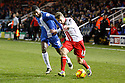 Luke Freeman of Stevenage battles with Mark Little of Peterborough - Peterborough United v Stevenage - Sky Bet League One - London Road, Peterborough - 23rd November 2013. <br /> © Kevin Coleman 2013
