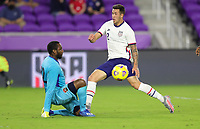 ORLANDO CITY, FL - JANUARY 31: Aaron Herrera #2 of the United States attempts a shot past Adrian Foncette #22 of Trinidad and Tobago during a game between Trinidad and Tobago and USMNT at Exploria stadium on January 31, 2021 in Orlando City, Florida.