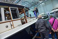 """55. Internationale Bootsmesse """"hanseboot"""" vom 25. Oktober bis 2. November 2014 zeigt alles rund um den Bootssport. Von Luxusyachten bis zum Kanu oder den einfachen Ruderboot und dem entsprechenden Zubehoer.<br /> Im Bild: Luxusmotoryacht """"Targa 44"""" der Finnischen Firma Targa.<br /> 27.10.2014, Hamburg<br /> Copyright: Christian-Ditsch.de<br /> [Inhaltsveraendernde Manipulation des Fotos nur nach ausdruecklicher Genehmigung des Fotografen. Vereinbarungen ueber Abtretung von Persoenlichkeitsrechten/Model Release der abgebildeten Person/Personen liegen nicht vor. NO MODEL RELEASE! Don't publish without copyright Christian-Ditsch.de, Veroeffentlichung nur mit Fotografennennung, sowie gegen Honorar, MwSt. und Beleg. Konto: I N G - D i B a, IBAN DE58500105175400192269, BIC INGDDEFFXXX, Kontakt: post@christian-ditsch.de<br /> Urhebervermerk wird gemaess Paragraph 13 UHG verlangt.]"""