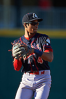 Peoria Chiefs shortstop Oscar Mercado (4) warmup throw to first during a game against the Lansing Lugnuts on June 6, 2015 at Cooley Law School Stadium in Lansing, Michigan.  Lansing defeated Peoria 6-2.  (Mike Janes/Four Seam Images)