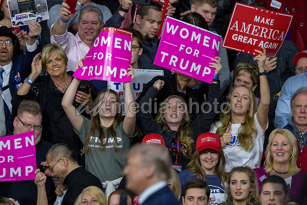 Supporters hold campaign signs a United States President Donald J. Trump speaks during a Make America Great Again campaign rally at Atlantic Aviation in Moon Township, Pennsylvania on March 10th, 2018. Photo Credit: Alex Edelman/CNP/AdMedia
