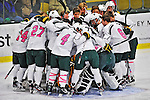 28 January 2012: The University of Vermont Catamount hockey team take a pre-game huddle at their net prior to facing the Northeastern University Huskies at Gutterson Fieldhouse in Burlington, Vermont. The Catamounts, dressed in their Breast Cancer Awareness jerseys, fell to the Huskies 4-2 in the second game of their 2-game Hockey East weekend series. Mandatory Credit: Ed Wolfstein Photo
