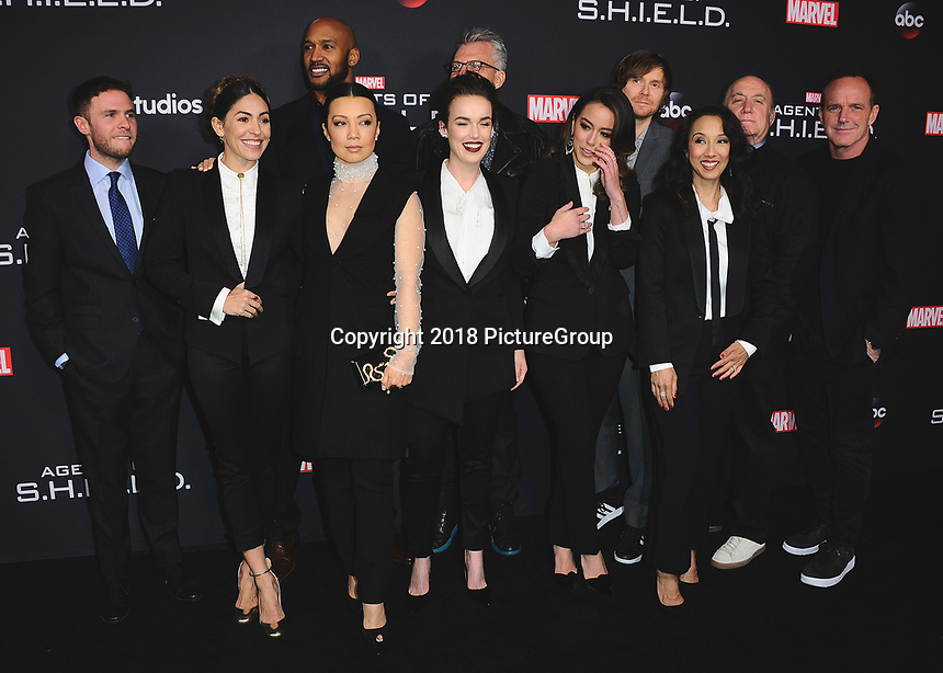 """HOLLYWOOD - FEBRUARY 24:  Iain De Caestecker, Natalia Cordova-Buckley, Henry Simmons, Ming-Na Wen, Elizabeth Henstridge, Jeffrey Bell, Chloe Bennet, Jed Whedon, Maurissa Tancharoen, Jeph Loeb and Clark Gregg at 100th Episode Celebration of ABC's """"Marvel's Agents of S.H.I.E.L.D.""""  at OHM Nightclub on February 24, 2018 in Hollywood, California.(Photo by Scott Kirkland/PictureGroup)"""