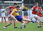 Keelan Sexton of Clare in action against Kevin Crowley of Cork during their National Football League game at Cusack Park. Photograph by John Kelly.