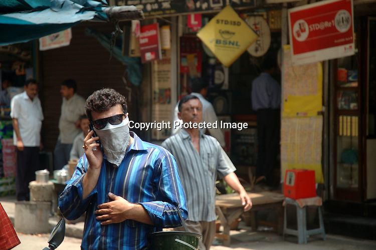 INDIA (West Bengal - Calcutta)  2007, An Indian man covers his nose with his handkerchief while talking on the cell phone. Heavy polluted areas cause nose and eye burning. A recent report by CNIC (CHITTARANJAN NATIONALCANCER INSTITUTE)  one of the most prominent cancer Institue of the country declairs Calcutta has the most air pollution in the country and 70% of its population suffers from respiratory and lung diseases. - Arindam Mukherjee