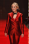 Maureen McCormick walks runway in a red pant suit, for the Red Dress Collection 2017 fashion show, for The American Heart Association, presented by Macy's at the Hammerstein Ballroom in New York City on February 9, 2017; during New York Fashion Week Fall 2017.