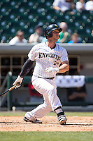 George Kottaras (20) of the Charlotte Knights follows through on his second home run of the game against the of the Indianapolis Indians at BB&T BallPark on June 21, 2015 in Charlotte, North Carolina.  The Knights defeated the Indians 13-1.  (Brian Westerholt/Four Seam Images)