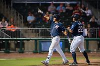 Northwest Arkansas Naturals infielder Angelo Castellano (16) (left) celebrates after hitting a home run on May 18, 2019, at Arvest Ballpark in Springdale, Arkansas. (Jason Ivester/Four Seam Images)