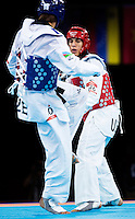 10 AUG 2012 - LONDON, GBR - Steven Lopez (USA) (right) of the USA looks for an opening to attack Ramin Azizov (AZE) of Azerbaijan during their men's -80kg category preliminary round contest at the London 2012 Olympic Games Taekwondo at Excel in London, Great Britain (PHOTO (C) 2012 NIGEL FARROW)