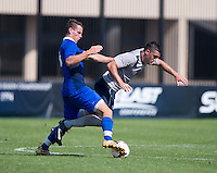 Brandon Allen (10) of Georgetown is fouled by Mateusz Brela (3) of Seton Hall during the game at Shaw Field in Washington, DC.  Georgetown defeated Seton Hall, 8-0.