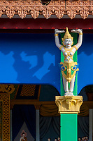 Cambodia, Bakong.  Apsara Holding up the Roof of a Buddhist Monastery Adjacent to the Ancient Temple.