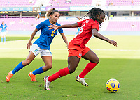 ORLANDO, FL - FEBRUARY 24: Tamires #6 of Brazil defends Deanne Rose #6 of Canada during a game between Brazil and Canada at Exploria Stadium on February 24, 2021 in Orlando, Florida.