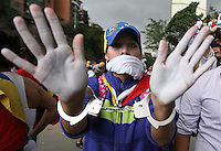 Venezuela: Caracas,18/02/14 <br /> a woman demonstrator show his hands scuffed during the rally in support of Leopoldo Lopez, in Plaza Brion in Caracas. Lopez was then handed to the National Guard, because the government had issued an arrest warrant against him responsible for the violence of the protest 12F, where two students and a member of a pro-government paramilitary group died. <br /> Adolfo Acosta/Archivolatino