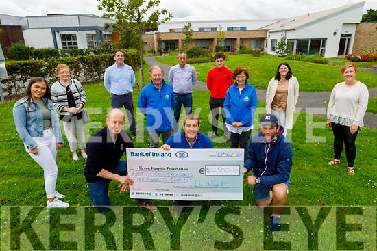 Denis Kennelly, John McGrath and Stephen Donegan present a cheque for €44,500 from the John McGrath soccer tournament to the Kerry Hospice on Friday. <br /> Kneeling l to r: Denis Kennelly, John McGrath and Stephen Donegan.<br /> Middle l to r: Joe Hennerbry and Mary Shanahan.<br /> Back l to r: Muireann Kennelly, Carmel and Donal McGrath, Maurice, Oisin and Clare Kennelly and Erin Stack.