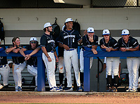 IMG Academy Ascenders bench (L-R) Drew Gray, Evan Clark, Mason Albright, Davion Hickson, Blaydon Plain, Joseph Slattery, and Aeden Finateri during a game against the Jesuit Tigers on April 21, 2021 at IMG Academy in Bradenton, Florida.  (Mike Janes/Four Seam Images)