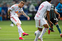 CARSON, CA - APRIL 25: Daniel Royer #77 of the New York Red bulls with a shot on goal during a game between New York Red Bulls and Los Angeles Galaxy at Dignity Health Sports Park on April 25, 2021 in Carson, California.