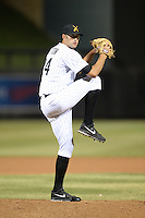 Salt River Rafters pitcher Kraig Sitton (24), of the Colorado Rockies organization, during an Arizona Fall League game against the Surprise Saguaros on October 15, 2013 at Salt River Fields at Talking Stick in Scottsdale, Arizona.  Surprise defeated Salt River 9-2.  (Mike Janes/Four Seam Images)
