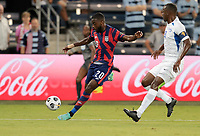 KANSAS CITY, KS - JULY 15: Shaq Moore #20 of the United States crosses a ball into the box during a game between Martinique and USMNT at Children's Mercy Park on July 15, 2021 in Kansas City, Kansas.