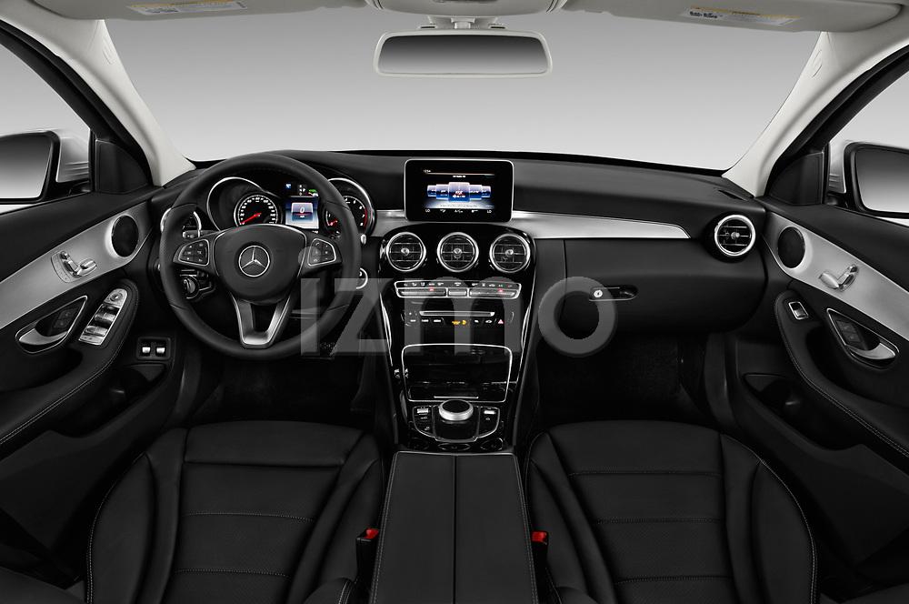 Stock photo of straight dashboard view of a 2018 Mercedes Benz C-Class Sedan C350e Plug-in Hybrid 4 Door Sedan
