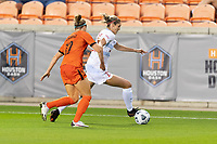 HOUSTON, TX - APRIL 09: Kayla Sharples #28 of the Chicago Red Stars keeps the ball away from Veronica Latsko #12 of the Houston Dash during a game between Chicago Red Stars and Houston Dash at BBVA Stadium on April 09, 2021 in Houston, Texas.