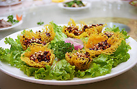 One of the dishes served at a restaurant in Beijing. Fried nests filled with pines on a bed of salad Beijing, China, Asia
