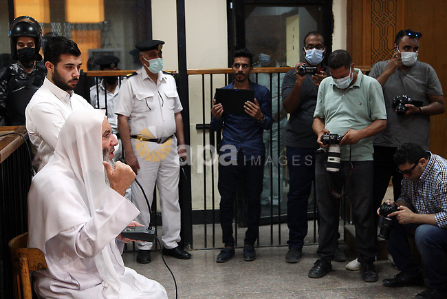 """Sheikh Mohammed Hassan delivers testimony at a Egyptian court in the case known as the """"ISIS Imbaba"""", in Cairo, Egypt on August 8, 2021. A group was formed that carried out a bombing in downtown Cairo, targeted a bank in Giza. According to case papers """"271 of 2021,"""" the group had pledged allegiance to ISIS and operated under the name """"ISIS Imbaba"""". Following their arrest, the group members did not hide the source of their ideas. They said they were students of Sheikhs Mohammad Hassan and Mohammad Hussein Yaqoub. Photo by Tahsin Bakr"""